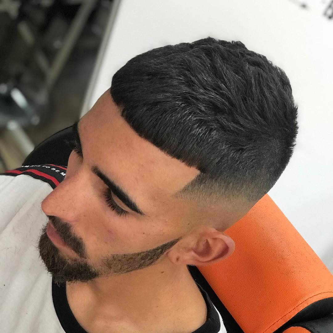 Elegant High Fade Haircut for Short Hair