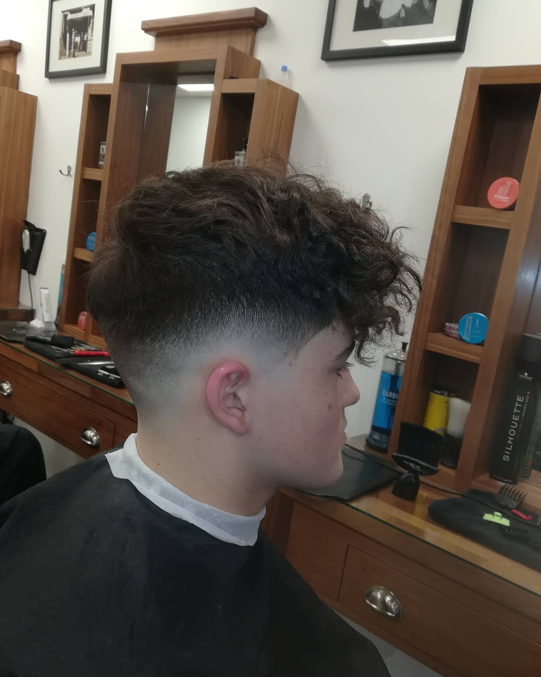 Messy, Curly Hair with Skin Fade